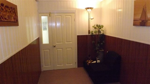 White entrance door to funeral room