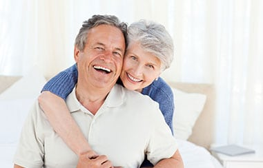 Happy elderly couple in an embrace